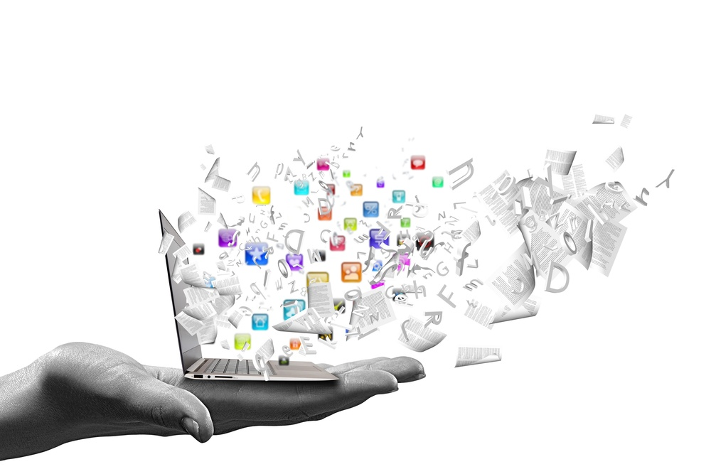 Close up of hand with laptop and media icons.jpeg